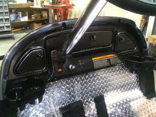 Locking carbon fiber dash with checker mat