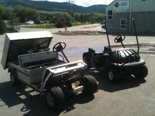 The carryall and the Outback's other cart for people moving