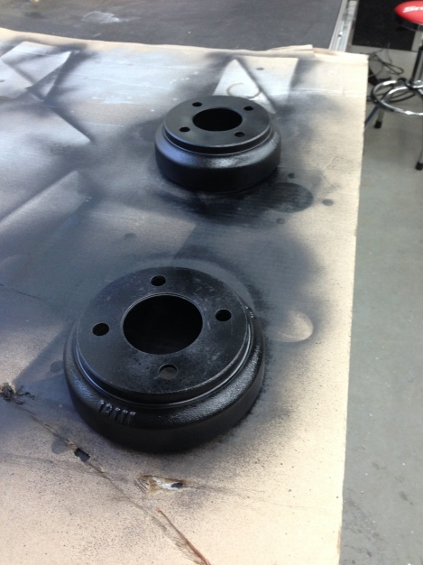 With spindle assemblies out we were able to disassemble the brake components. We started by stripping the old paint and surface rust off of the drums and then prepping and painting them.