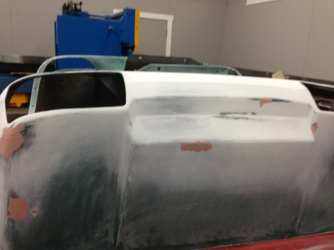 "Here we apply small amounts to the needed areas. Anywhere the plastic has been sanded through and has created a ""fuzzy"" surface, must be repaired and primed. If this process is not completed you will end up with the ""fuzzy"" surface coming through the final paint job!"