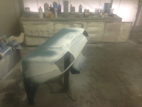 With all our repairs completed and a complete 400 grit sanding, then a 600 grit sanding. We were able to move the cowlings into the paint booth.