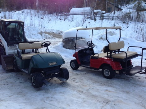 Here we are bringing the cart in while we move the Albertan resort cart to our storage shop. One out the next in!