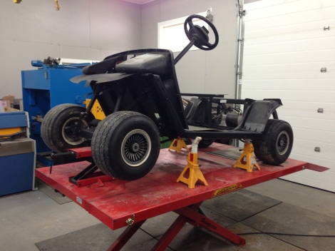 With the body painted we got the chassis back on the lift so we can prepare it for the lift kit.