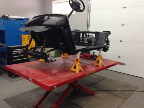 We got the cart secured on the jack stands and removed the front and rear wheels.