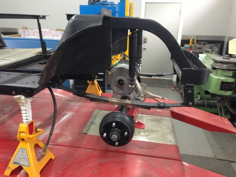 We dropped the axle underneath the leaf springs, and have it sitting on our jack to allow for the proper height adjustment when the lift is installed.