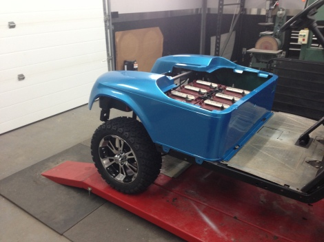 It was time to install the rear body on this cart. The tire package looks awesome with this color.