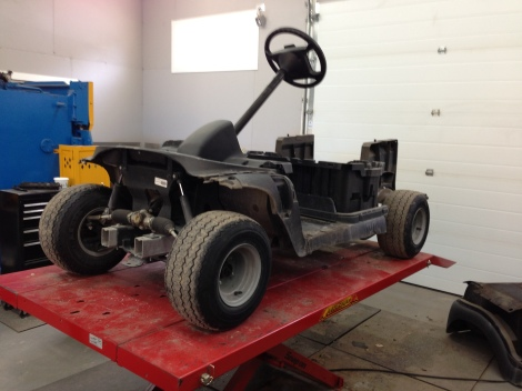 We then removed the rocker panels, the wheel covers and the floor mat. The cart is now ready to be pressure washed.