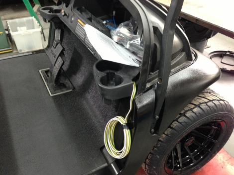 Here we are running a flat 4 wire inside the passenger side roof support to provide power to the stereo system.
