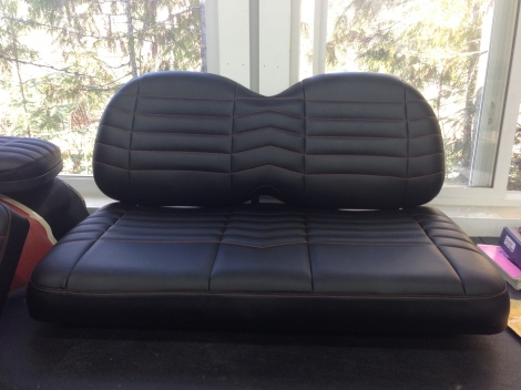 Our customer wanted to maintain the all black look of the seats, so we added some simple orange accent stitching with the same rib design as the real F350.
