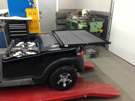 We installed the main body and then started in on the Club Car Precedent rear folding seat box kit. Also notice the pinstripes on the main body as well.