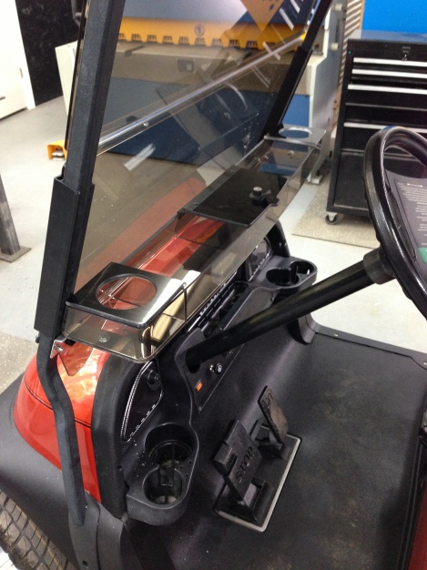 After test fitting and cleaning up the custom brackets we installed the dash tray. This cart will be plenty organized.