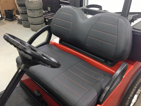 Here is a close up of the custom upholstery with the contrasting orange stitching.