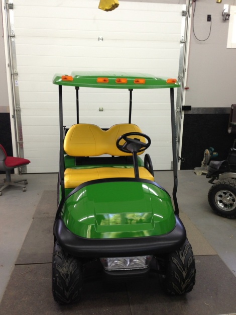 To add a little John Deere tractor style to the Club Car, we installed some roof marker lights.