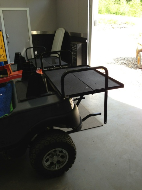 This electric buggy is going to be put to work hauling people, so it gets a folding rear seat kit.