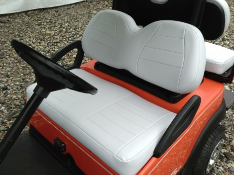 Checkout the carbon fiber white upholstery with the orange stitching. What a sporty look!