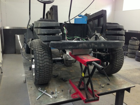With the back end supported we are able to gain access to remove the rear lift kit.