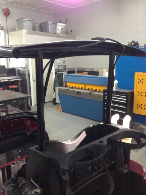 We then brought the cart back in and hooked up the custom Club Car Precedent solar charging system.