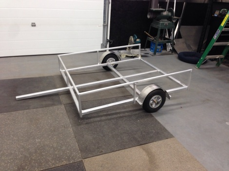 Here is the trailer frame on the ground. It is amazing how light and yet stiff this little trailer is. It's going to be a perfect work trailer for the Club Car Precedent. With its low height it will make loading items in and out easy!