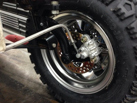 Another shot of the Club Car hydraulic brake system tucked into the custom rims.
