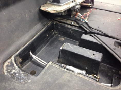 Once we routed the assembly through the floor pan, we re used the plug that we drilled out to patch the hole. This will keep everything tidy for when we are cruising through the deep water.