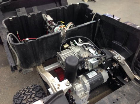 You can see it is a tight squeeze within to give it clearance on the Club Car electric motor, but we got it.