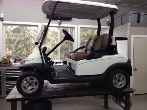 The first step we take in preparing an electric golf cart for winter storage is to pressure wash the entire cart. That means the under carriage the body, the battery compartment, the roof, the dash area etc... You want to get all the grass and dirt build up from the season off so you have a nice clean vehicle to work with. Next get it in a suitable work environment. For us that means in the shop and up on the work table.