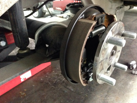 The first thing we do is get the lift under the rear end and get the tires off so we can access the brakes.