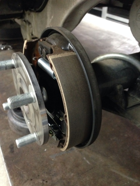 We like to then take compressed air and blow the brakes off along with the brake drums. Next we inspect for any damaged or loose parts that need to be addressed. We also pay close attention to the brake pads to see if they are hard surfaced and also if they have sufficient pad material left.