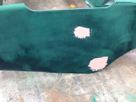 With the initial sanding of the golf cart body complete, we tended to the imperfections that could not be sanded out. Although this may look like Bondo it is not, this is a special plastic filler designed to remain flexible with the body.