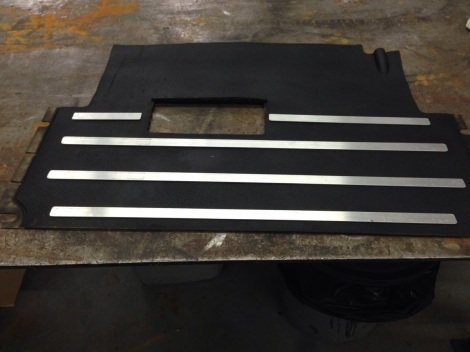 Here is the start to one of our custom Precedent floor mats.