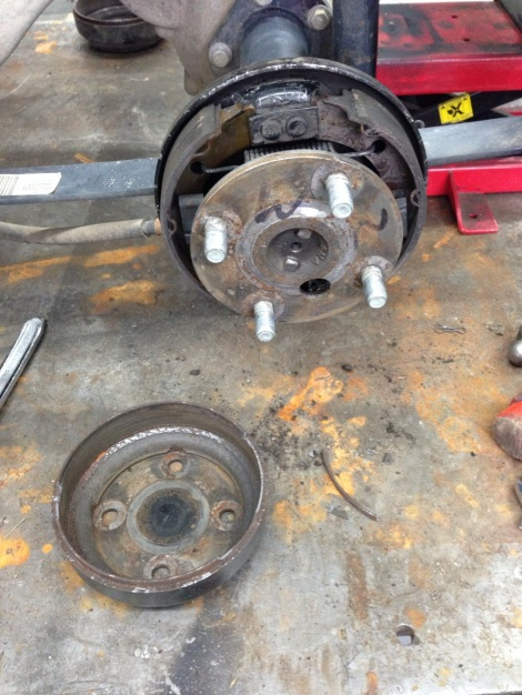 After getting the front end under control we moved onto the rear drivetrain and found a problem. Here you can see the drum was  broke apart trying to remove it from the brake pads. This drum had been hanging up and creating heat.