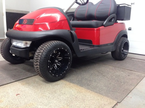 Here's a great shot of this electric buggy showing just how well all the custom pieces tie in together. The grill matches the rims and the rims match the mat sill plates. This cart has to put a smile on your face :)