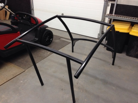 With the music taken care of we needed to think about keeping the passengers shaded. Here our SC Carts roof frame is back from powder coat and ready for the windscreen and roof panels.
