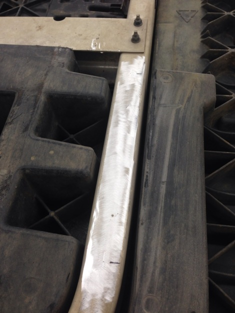 We then made a couple measurements on each frame rail and marked out a couple holes.