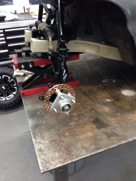 "Next we installed the front discs for the upgraded hydraulic brake system, along with the 6"" lift kit."