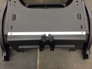 Our customer also wanted the addition of front and rear seat belts. Here you can see we tied the seat belts into the main underbody attach points by using a piece of aluminum flat bar. This is also captured on the back side as well.