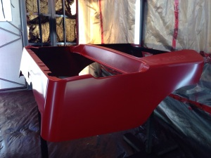 With the primer dry and a wet sand complete we laid down the red base coat.