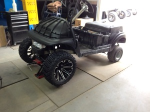 """While the body dries we moved onto installing the 14"""" HD3 rims with the 23"""" blade EFX tires."""