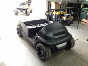 The flat black body is now installed on the Club Car chassis, this cart looks mean!