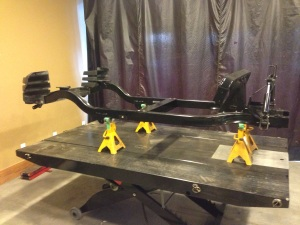 This is getting serious. We moved the LUXE edition Precedent chassis to the lift table and got it settled on jack stands.
