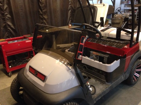 To bring some red to the front of the cart, we machined a set of custom windsheild wings and a custom red grill